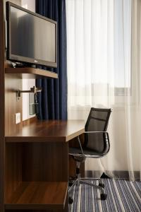 A television and/or entertainment center at Holiday Inn Express Arnhem