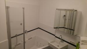 Ein Badezimmer in der Unterkunft Apartment Rhein Main