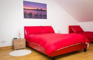 A bed or beds in a room at Abateg Self Catering