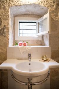 Een badkamer bij Masseria Cianciò