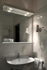 Ein Badezimmer in der Unterkunft Fair Hotel am Rathaus