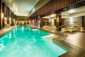 The swimming pool at or near Hilton Queenstown Resort & Spa