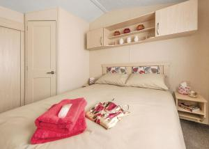 A bed or beds in a room at Lime Tree Park
