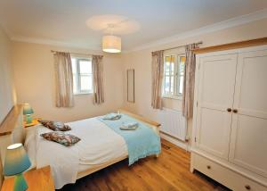 A bed or beds in a room at Oak Farm Lodges
