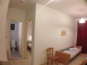 Een badkamer bij Manine Apartments