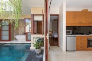 A kitchen or kitchenette at Beautiful Bali Villas by Nagisa Bali