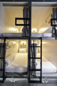 A bunk bed or bunk beds in a room at The Cube Hostel