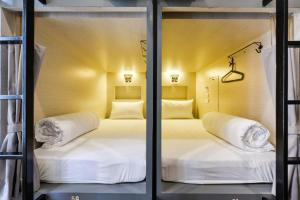 A bed or beds in a room at The Cube Hostel