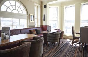 A seating area at White Horse Hotel by Greene King Inns