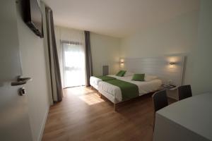 A bed or beds in a room at Arc en Ciel Oléron