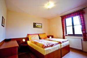 A bed or beds in a room at Apartmány Vidim