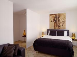 Ein Bett oder Betten in einem Zimmer der Unterkunft VISIONAPARTMENTS Chemin des Epinettes - contactless check-in