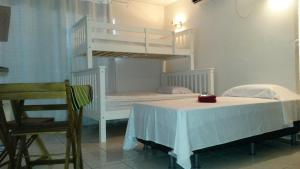 A bunk bed or bunk beds in a room at Cumaru Flat Manaus 916