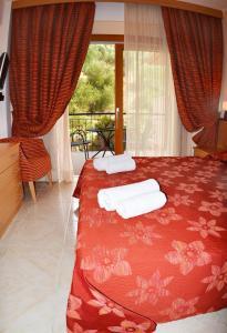Ένα ή περισσότερα κρεβάτια σε δωμάτιο στο Petros Italos