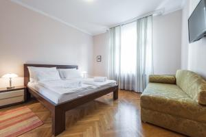 A bed or beds in a room at Apartment Dobrinjska