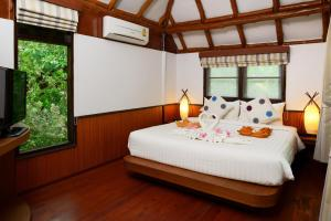 A bed or beds in a room at Montalay Beach Resort