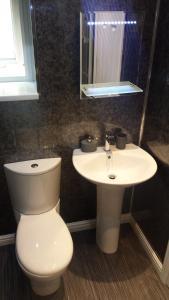 A bathroom at Sunrise Avenue Hotel