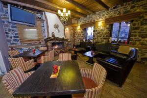 Ресторант или друго място за хранене в Guesthouse Elati - Pella
