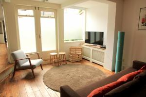 A seating area at Apartment Keyzers Secret