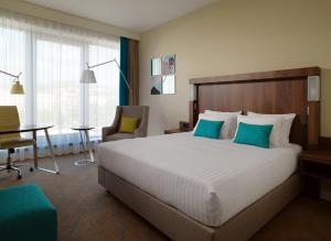 A bed or beds in a room at Courtyard by Marriott Sarajevo