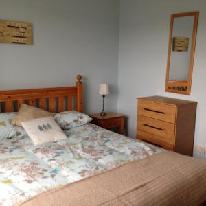 A bed or beds in a room at The Alders
