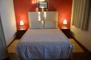 A bed or beds in a room at Vouni Lodge