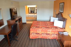 A bed or beds in a room at Royal Inn Greenville