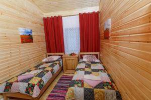 Кровать или кровати в номере Загородный клуб Афанасий
