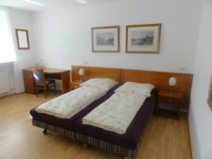 Ein Bett oder Betten in einem Zimmer der Unterkunft Hotel Mila