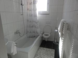 Ein Badezimmer in der Unterkunft Hotel Mila