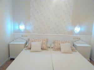 Cama o camas de una habitación en Apartamentos Pájaro Azul