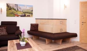 Ein Sitzbereich in der Unterkunft Alp Chalet Appartement