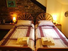 A bed or beds in a room at The Old Bakehouse