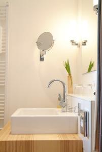 Ein Badezimmer in der Unterkunft Parkhotel Wolfsburg