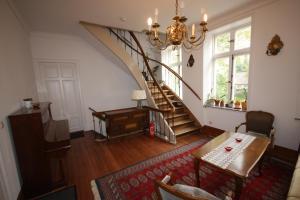 Ein Sitzbereich in der Unterkunft Herrenhaus Hohewarte