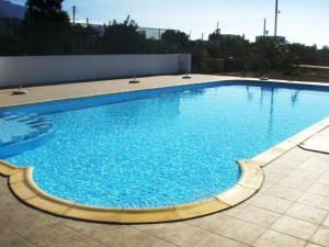 The swimming pool at or near Flisvos Apartments