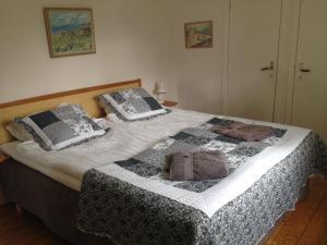 Säng eller sängar i ett rum på Hermanslycke Bed & Breakfast