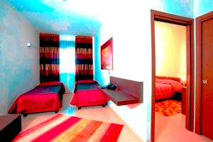 A bed or beds in a room at Hotel Massimino