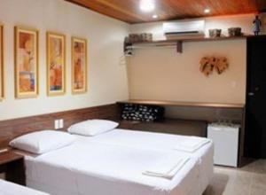 Cama ou camas em um quarto em Pousada Fazenda Santa Fe