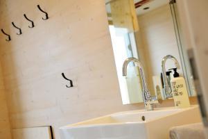 Ein Badezimmer in der Unterkunft Hainichhöfe Premiumchalets