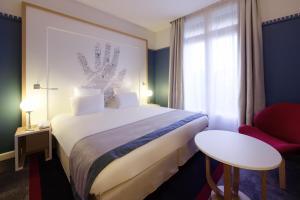 Кровать или кровати в номере Mercure Lyon Centre Château Perrache