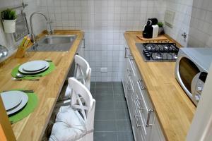 Una cocina o zona de cocina en LE QUATTRO MURA EXCLUSIVE