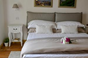 Cama o camas de una habitación en LE QUATTRO MURA EXCLUSIVE