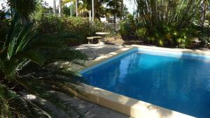 The swimming pool at or near Bel Air Motel