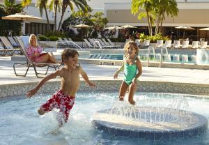 The swimming pool at or near Hilton Orlando Lake Buena Vista - Disney Springs™ Area