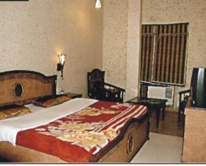 Ein Bett oder Betten in einem Zimmer der Unterkunft Holy City Golden Temple