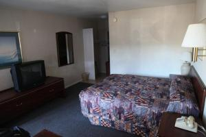 A bed or beds in a room at Seatac Inn