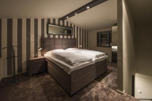 Een bed of bedden in een kamer bij Hotel-Restaurant Unicum Elzenhagen