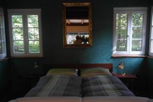 Ein Bett oder Betten in einem Zimmer der Unterkunft Presshaus Alte Mühle