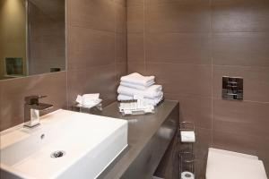 A bathroom at Donnington Manor Hotel